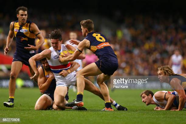 Bailey Williams of the Bulldogs gets tackled by Josh Kennedy and Jack Redden of the Eagles during the round eight AFL match between the West Coast...
