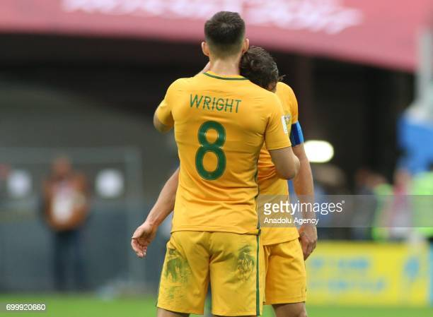 Bailey Wright and Mark Milligan of Australia gesture at the end of the Confederations Cup 2017 match between Cameroon Australia at SaintPetersburg...