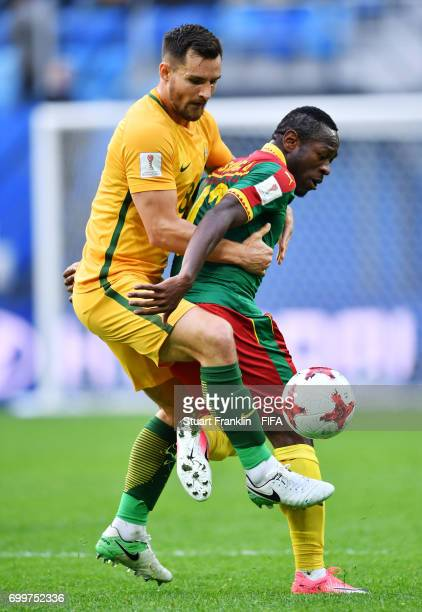 Bailey Wright of Australia and Christian Bassogog of Cameroon battle for possession during the FIFA Confederations Cup Russia 2017 Group B match...