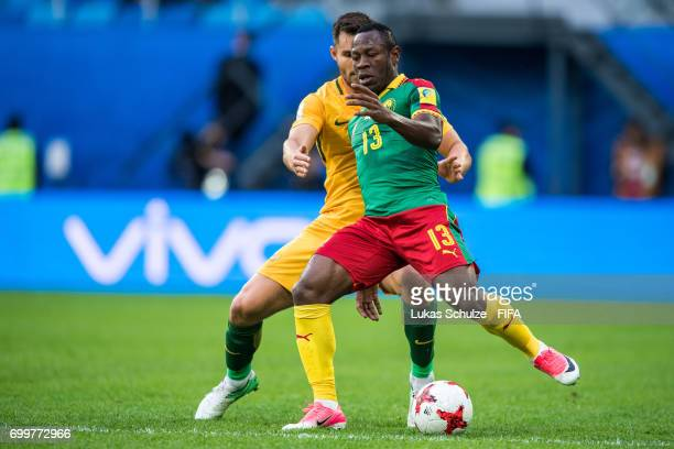 Bailey Wright of Australia and Christian Bassogog of Cameroon fight for the ball during the FIFA Confederations Cup Russia 2017 Group B match between...