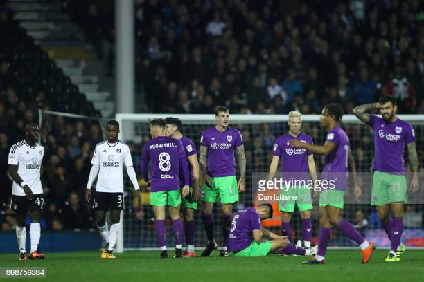 Bailey Wright of Bristol City lies on the turf after an incident with Aboubakar Kamara of Fulham during the Sky Bet Championship match between Fulham...