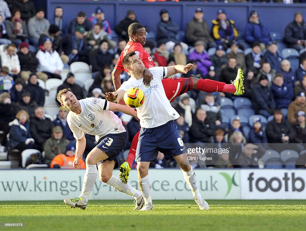 Bailey Wright (Bottom) of Preston North End and <a gi-track='captionPersonalityLinkClicked' href=/galleries/search?phrase=Kevin+Lisbie&family=editorial&specificpeople=226902 ng-click='$event.stopPropagation()'>Kevin Lisbie</a> (Top) of Leyton Orient battle for the ball during the Sky Bet League One match between Preston North End and Leyton Orient at Deepdale on February 15, 2014 in Preston, England.