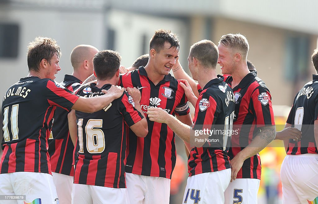 Bailey Wright (C) of Preston North End is congratulated by team mates after scoring their second goal during the Sky Bet League One match between Coventry City and Preston North End at Sixfields Stadium on August 25, 2013 in Northampton, England.