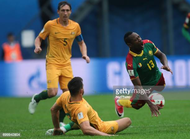 Bailey Wright of the Australia national football team and Christian Bassogog of the Cameroon national football team vie for the ball during the 2017...
