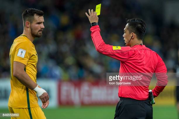 Bailey Wright of the Australian National Football Team gets shown a yellow card after a contest during the FIFA World Cup Qualifier Match Between the...