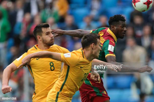 Bailey Wright Trent Sainsbury of the Australia national football team and AndreFrank Zambo Anguissa of the Cameroon national football team vie for...