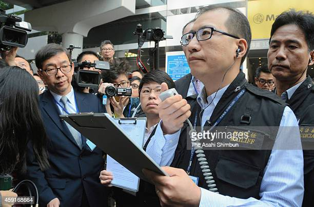 A bailiff announces to start the removal work of barricades set up by prodemocracy activists on November 18 2014 in Hong Kong bailiffs oversaw the...