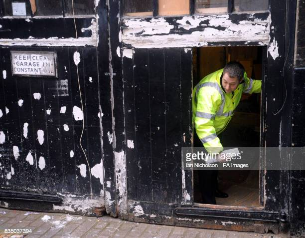 A bailiff enters a property in Clarges Mews west London as squatters who took over a 225 million Mayfair house must leave the property today the...