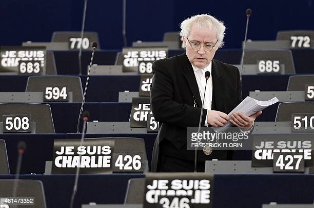 A bailiff of the European Parliament distributs pamphets prior to a debate on Italys outgoing EU Presidency at the European Parliament on January 13...