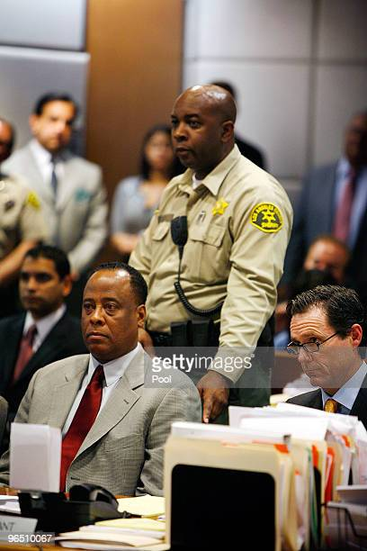 A bailiff reaches to take Dr Conrad Murray into custody as he is arraigned in the County of Los Angeles Airport Branch Courthouse on a charge of...