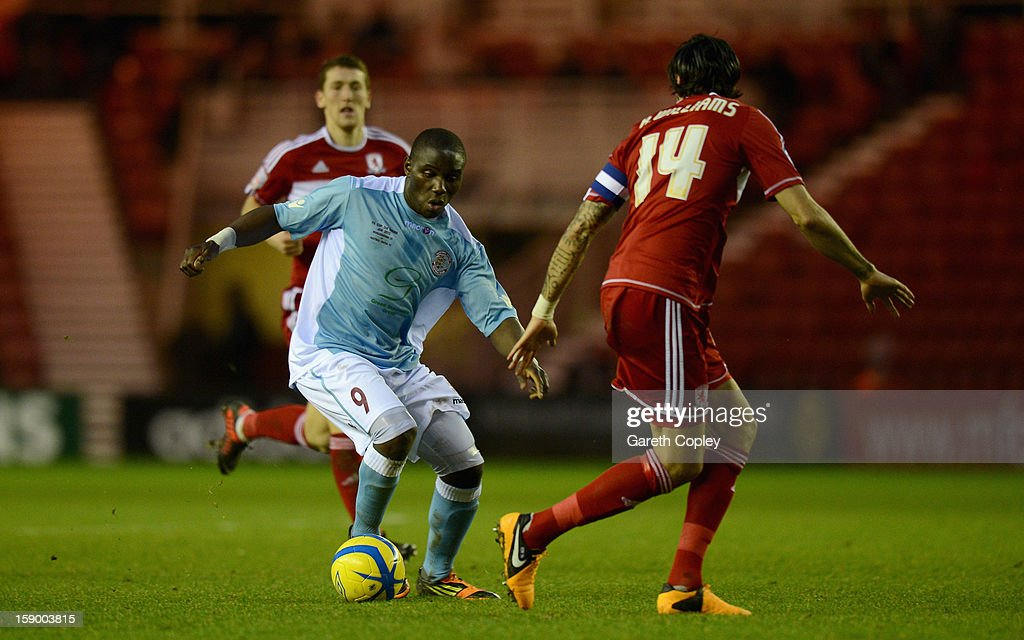 Bailo Camara of Hastings gets past <a gi-track='captionPersonalityLinkClicked' href=/galleries/search?phrase=Rhys+Williams+-+Soccer+Player&family=editorial&specificpeople=13424416 ng-click='$event.stopPropagation()'>Rhys Williams</a> of Middlesborough during the FA Cup with Budweiser Third Round match between Middlesbrough and Hastings United at Riverside Stadium on January 5, 2013 in Middlesbrough, England.