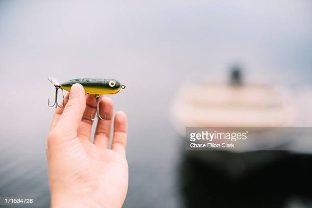 Bait in hand by lake