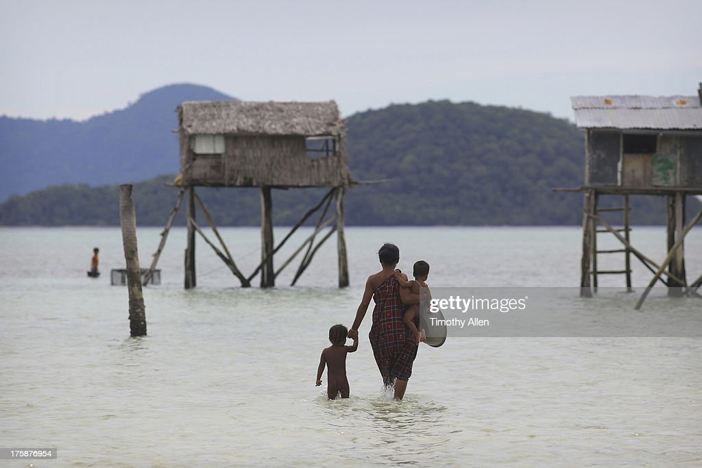 Bajau floating village on a reef at sea : Stock Photo