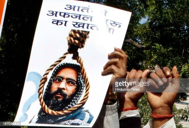 Bajrang Dal activists celebrate after Indian Home Minister Sushil Kumear Shinde confirmed Afzal Guru JaisheMohammad militant convicted in the...