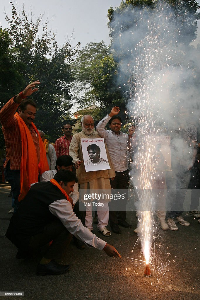 Bajrang Dal activists light crackers as they celebrate the hanging of Ajmal Kasab the sole surviving Pakistani terrorist involved in the Mumbai...