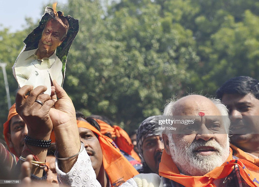 Bajrang Dal members burn an effigy of Union Home Minister Sushilkumar Shinde over his Hindu terror remarks in New Delhi on Tuesday.