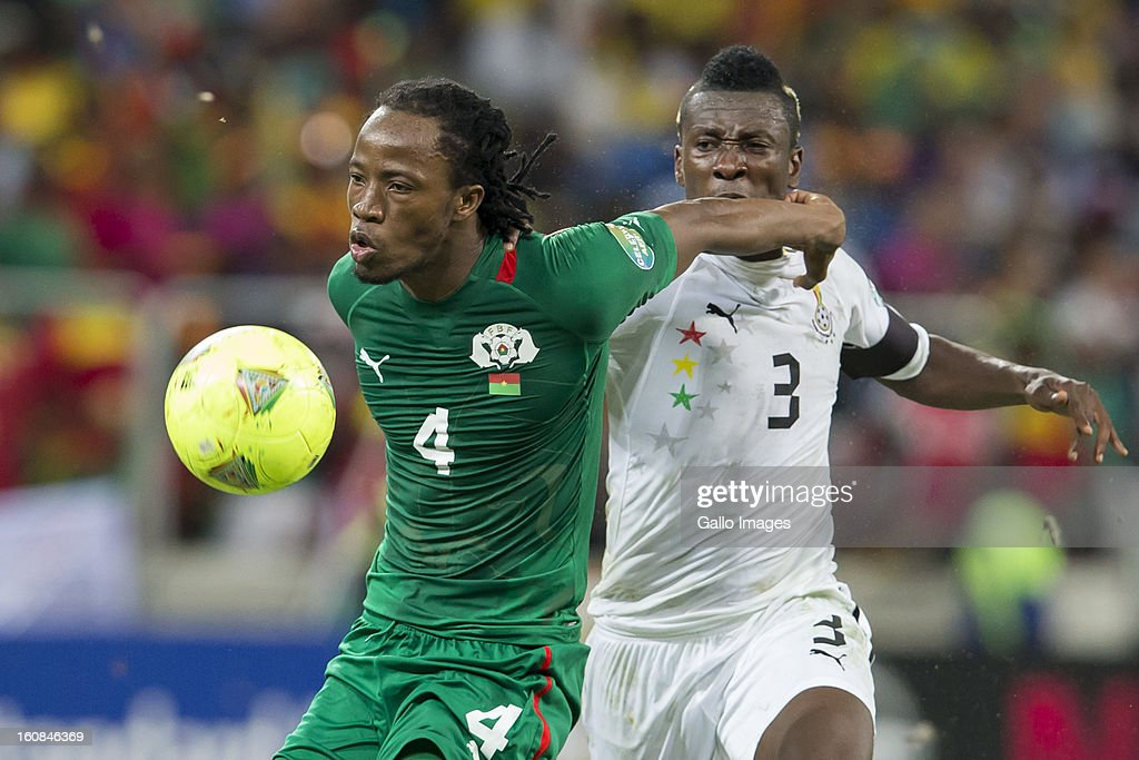 Bakary Kone from Burkina Faso (L) and <a gi-track='captionPersonalityLinkClicked' href=/galleries/search?phrase=Asamoah+Gyan&family=editorial&specificpeople=535782 ng-click='$event.stopPropagation()'>Asamoah Gyan</a> (Captain) from Ghana compete for the ball during the 2013 Orange African Cup of Nations 2nd Semi Final match between Burkina Faso and Ghana at Mbombela Stadium on February 06, 2013 in Nelspruit, South Africa.