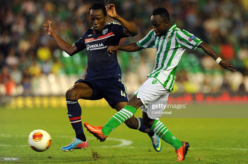 Bakary Kone (L) of Olympique Lyonnais challenges Cedric of Real Betis Balompie during the UEFA Europa League group stage match between Real Betis Balompie and Olympique Lyonnais held on September 19, 2013 at the Benito Villamarin Stadium, in Seville, Spain.
