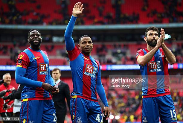 Bakary Sako Jason Puncheon and Mile Jedinak of Crystal Palace celebrate victory after The Emirates FA Cup semi final match between Watford and...
