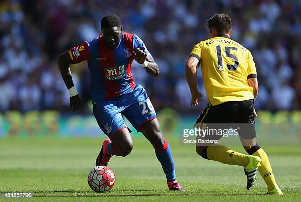 Bakary Sako of Crystal Palace and Ashley Westwood of Aston Villa compete for the ball during the Barclays Premier League match between Crystal Palace...