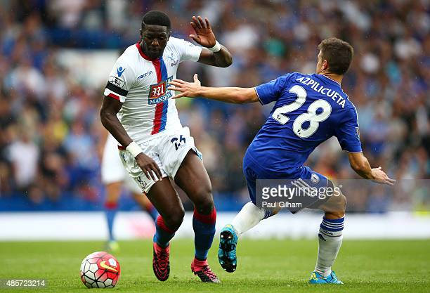 Bakary Sako of Crystal Palace and Cesar Azpilicueta of Chelsea compete for the ball during the Barclays Premier League match between Chelsea and...