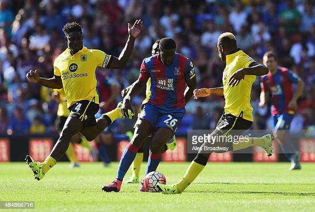 Bakary Sako of Crystal Palace competes against Micah Richards Leandro Bacuna of Aston Villa during the Barclays Premier League match between Crystal...
