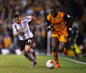 Bakary Sako Of Wolverhampton Wanderers and Patrick Roberts of Fulham during the Sky Bet Championship match between Fulham and Wolverhampton Wanderers...