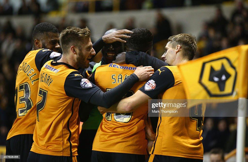Bakary Sako of Wolverhampton Wanderers celebrates his penalty goal with team mates during the Sky Bet Championship match between Wolverhampton...