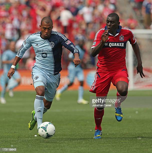Bakary Soumare of the Chicago Fire battles for the ball with Teal Bunbury of Sporting Kansas City during an MLS match at Toyota Park on July 7 2013...