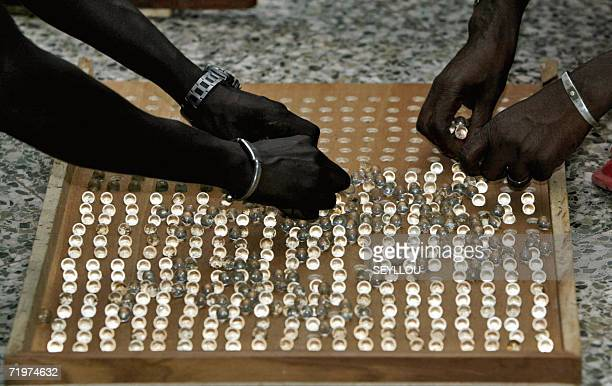 Election officials set up marbles on a board to count the votes after the presidential elections in Bakau early 22 September 2006 Early results today...