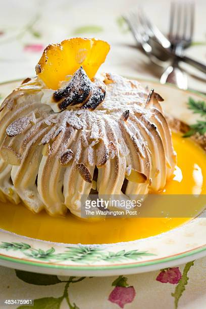 Baked Alaska at Le Vieux Logis restaurant in Bethesda MD 2014 Baked Alaska dessert topped with pinapple and sauce