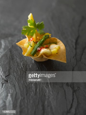 Baked basket stuffed with asparagus and potato salad garnish with cress on rock : Stock Photo