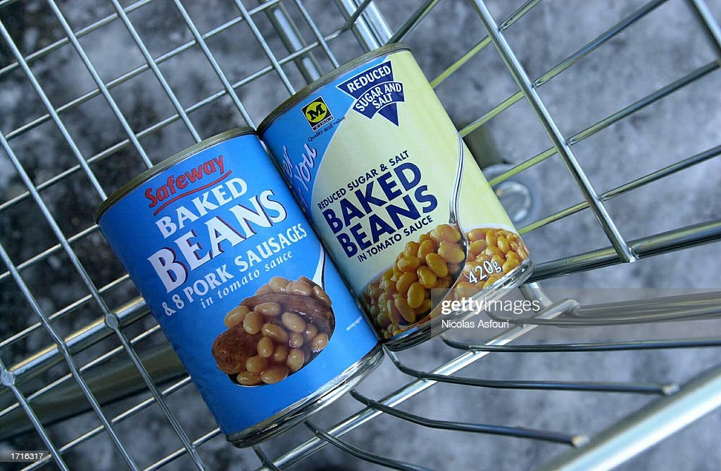 Baked bean cans with a Safeway and Morrisons label are displayed in a shopping cart outside a Morrisons supermarket January 9, 2003 in London. The mid-size British supermarket chain, Morrisons, announced its bid to overtake rival Safeway in a 2.9 billion pound deal that would combine the firm with 589 stores and a 16 percent market share.