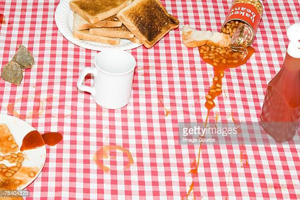 Baked beans spilt on tablecloth