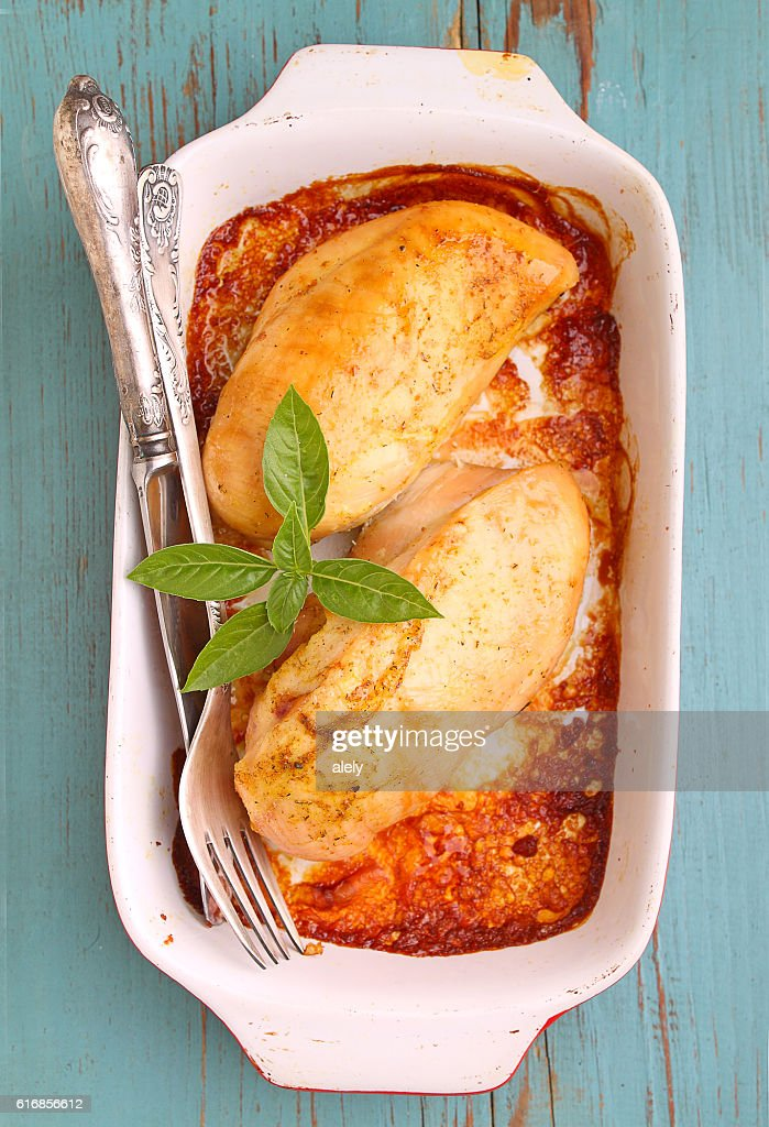 Baked breast of chicken in the white dish : Stock Photo