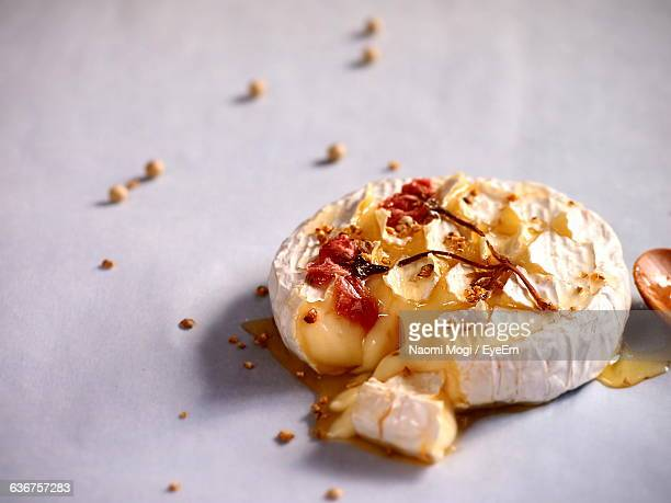 Baked Camembert Cheese With Agave Syrup And Pickled Cherry Blossoms On Top