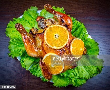 Baked chicken with oranges : Stock Photo