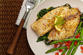 Whitefish with Roasted Asparagus. Selective focus.