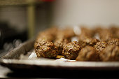 Baked meatballs on a baking tray