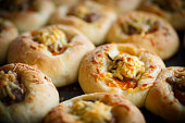 baked open pies with meat, tomato and cheese
