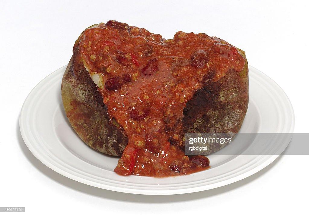Baked potato and chilli con carne : Bildbanksbilder