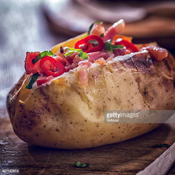 Baked Potato with Sour Cream, Bacon and Chili