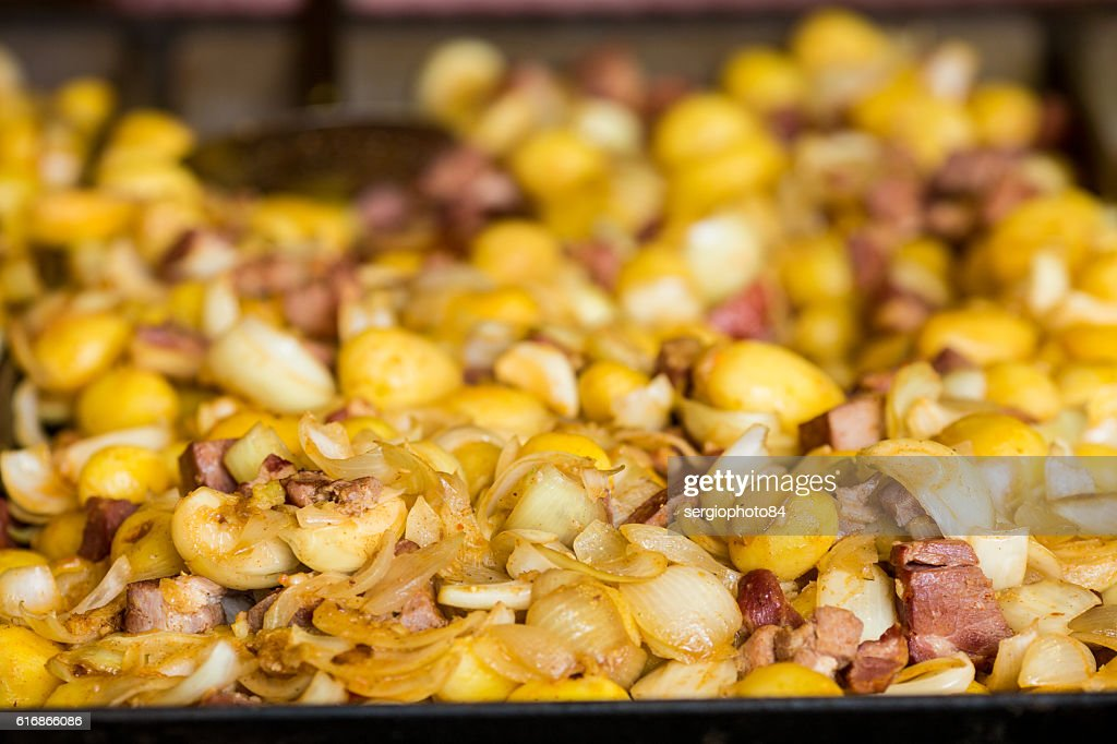 Baked potatoes for sale at the banquet on the street : Stock Photo