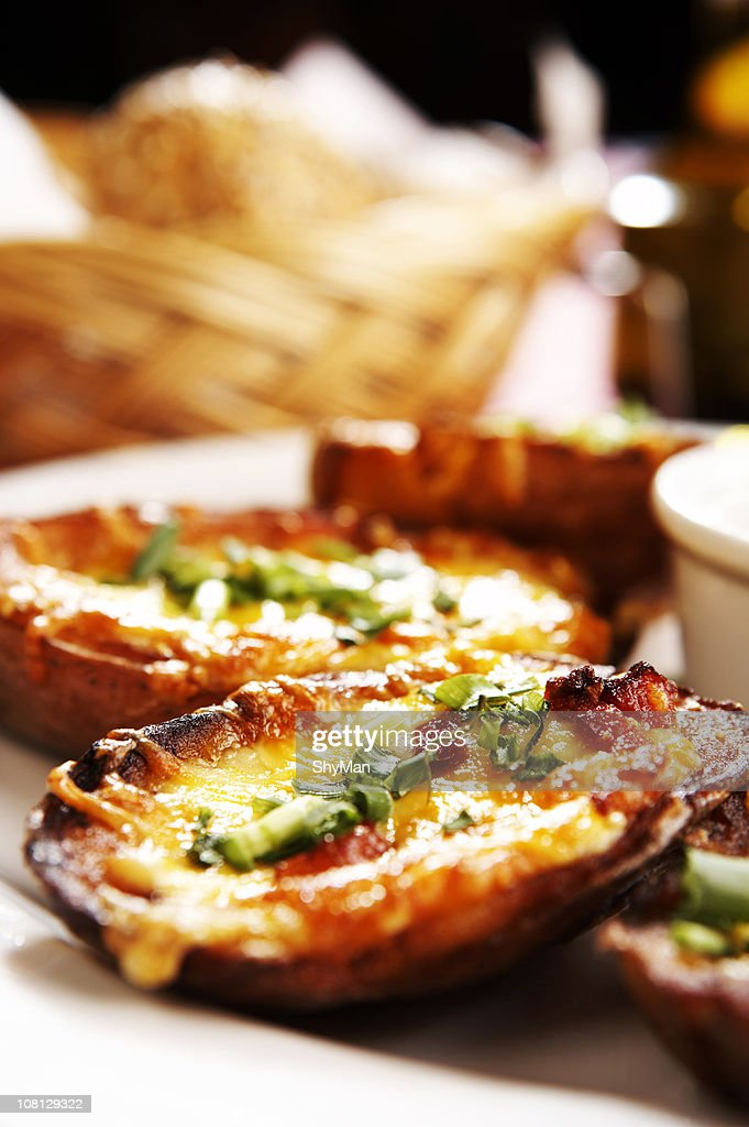 Baked Potatoes stuffed with cheese and bacon : Stock Photo