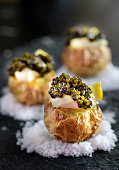 Baked Potatoes with Black Caviar and Sour Cream