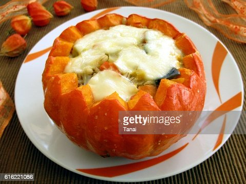 Baked pumpkin stuffed with vegetables and mozzarella : Stock-Foto