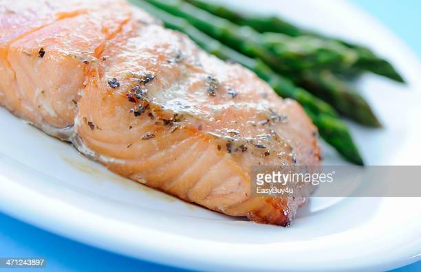 Baked salmon and asparagus served on a plate