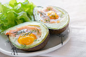 Baked smoked salmon, egg in avodaco, ketogenic keto low carb diet food