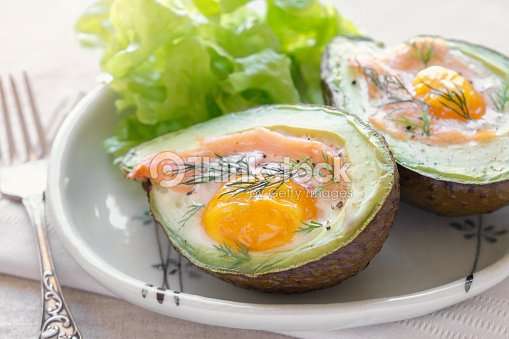 Baked smoked salmon, egg in avodaco, ketogenic keto low carb diet food : Stock Photo