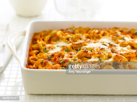 Baked tortellini in tomato sauce with cheese.